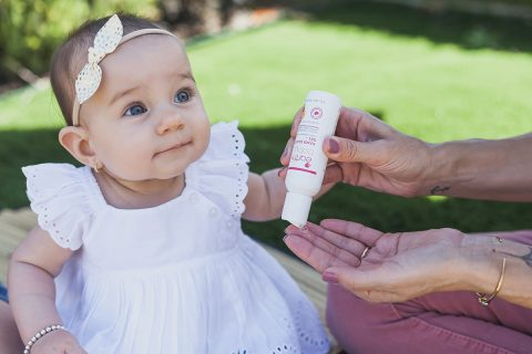 Baby with Hand Sanitizer